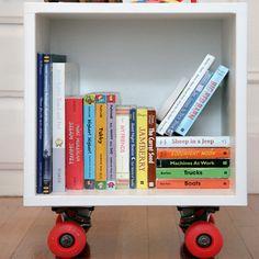 diy bookshelf cubby on wheels - great for big-size kids books that don't fit on regular shelves.
