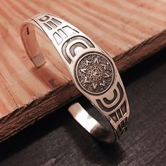 """‼️‼️Aztec Calendar Sterling Silver Cuff Stamped """"Mexico 925"""".   This is not a stock photo. The image is of the actual article that is being sold  Size: 7 adjustable  Sterling silver is an alloy of silver containing 92.5% by mass of silver and 7.5% by mass of other metals, usually copper. The sterling silver standard has a minimum millesimal fineness of 925.  All my jewelry is solid sterling silver. I do not plate.   Hand crafted in Taxco, Mexico.  Will ship within 2 days of order or sooner…"""