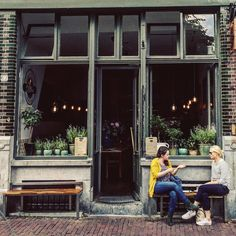 A little throwback to the street scenes in Amsterdam. How cute are all these plants  in this cafe window? #thursdaythrowback #streetphotography #amsterdam #travelgram #vscocam #lifestyle #cafelife #gramthedam