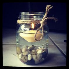 Pebble. Floating. Candle. Mason. Jar. Twine. I want to do this to match the rest of my natural rock in my house.