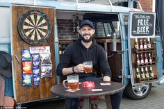 Car nutBen Levy, 29, spent months painstakingly transforming his Volkswagen 1957 Splitscreen into his personal watering hole. Pictured: Ben enjoying a pint outside his mobile pub