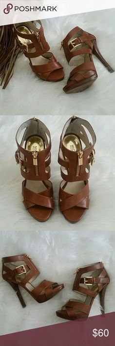 """Michael Kors heeled sandals Beautiful cognac Michael Kors Strappy Sandals. Featuring a side buckle and front and back zipper entry. Heel measures 5 1/2"""". Very clean inner soles and normal wear to bottoms. Overall in great conditon. Original box not included. Michael Kors Shoes Heels"""