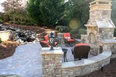 Paver Patio with Outdoor Fireplace and Water Fall Feature