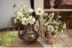 vintage tea and coffee pots as flower holders