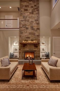 Utilizing space on sides of Stone Fireplace .love the lighting