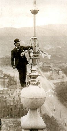 Famous photo of E. G. Holding atop a spire of the Salt Lake Temple.  He installed the electrical lighting.