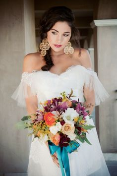 Spanish inspired wedding gown from Miss Tashina, featured in Style Me Pretty.