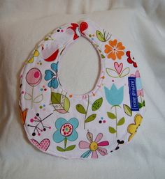 This super chic and stylishly contoured bib is perfect for even the messiest of spits & spills.    It has an adjustable Velcro closure, which means...