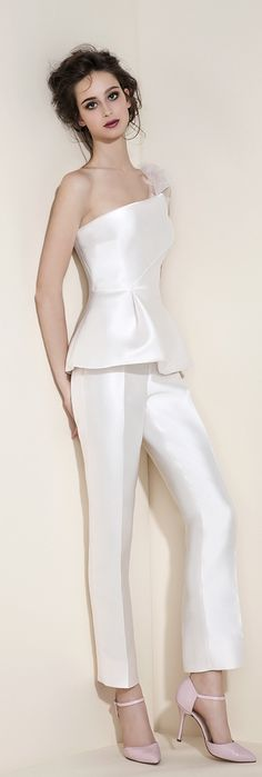 It& always better to be on the safe side. The Safe Side Jumpsuit features a one shoulder silhouette, zip closure at side, hook closures at shoulder, cut-out detailing with tie belt at side, and decorative pockets at front. Bridal Pants, Wedding Jumpsuit, Cute Winter Outfits, Classy Outfits, Wedding Trouser Suits, One Shoulder Jumpsuit, Look 2018, Strapless Jumpsuit, Cocktail Gowns