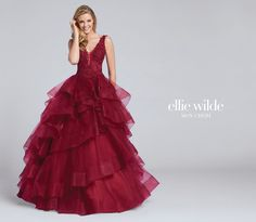 Ellie Wilde EW117081 - Sleeveless tulle ball gown with lace and heat-set stone bodice, plunging V-neckline with illusion modesty panel, low scooped back, voluminous asymmetrically layered and tiered tulle skirt with horsehair trim.