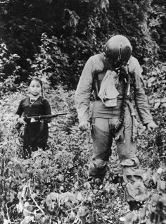 US Air Force POW being held captive by a young North Vietnamese girl