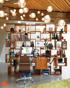 What a neat room divider - doesn't obstruct view!  And the lights give it a hollywood, mid century aura!