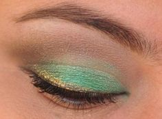 Emerald green shadow with glittery gold liner.