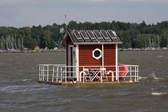 This is a floating hotel/room in Sweden. It's so going on my bucket list! :D