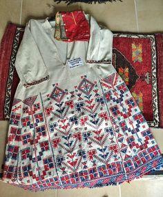 Traditional bridal/festive 'göynek' (underdress) from the village of Hamzacık (ca. 20 km NW of Dursunbey, in the eastern part of the Balıkesir province).  Ca. mid-20th century.  Ethnic group: Türkmen.  Cotton, lavishly adorned with cotton embroidery (stylized flowers and tree-of-life motifs). (Source: Uğur Çelikkol, Karagöz Turizm, Bursa).