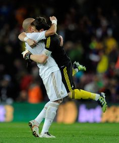 After Real Madrid's victory against Barca. Awesome flying hug, Iker!