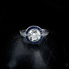 A Gorgeous and Rare Vintage Diamond and Sapphire Halo Engagement Ring. Sold by Estate Diamond Jewelry.
