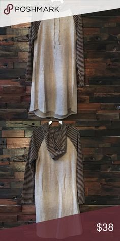 "Hoodie dress Mocha colored hoodie dress. Striped long sleeved detail. So detest dress ever!!!! Or you can wear as a long top with leggings.  Length is 36"". Small fits 0-4, medium fits 4-8, large fits 10-12. 96% polyester, 4% spandex. chris and carol Dresses Midi"