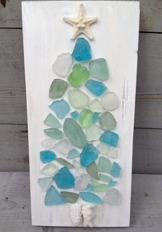 Merry Beachy Christmas....... The reclaimed wood art is painted white and measures approximately 11H x 5W. I created a tree using seaglass pieces