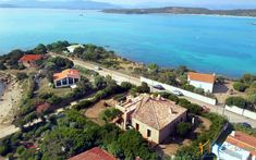 Villa Petra is a beachfront villa for sale Olbia, set at the tip of Mare e Rocce seaside hamlet, in south-after Pittulongu, just a stone's throw away from the sea. You are in the territory of Olbia, a dynamic town on the north-eastern coast, a tourist crossroads for the Costa Smeralda and one of the most important economic hubs of the island. Villa Petra was built in 2010 with high quality finish, matching the standards of the luxury villas for sale inPorto Rotondo and Golfo Aranci. Island Villa, Stones Throw, Sardinia, Luxury Villa, Petra, Minimalist Design, Villas, Seaside, Costa