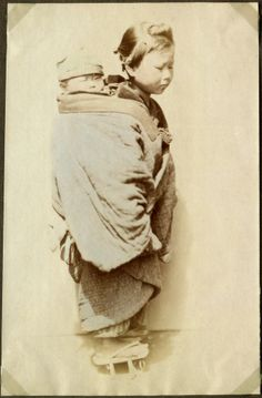 Young girl with a child (little brother) on her back