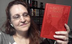 Carma Spence, The Genre Traveler, holding a copy of The Battles of Tolkien by David Day Tv Reviews, Tolkien, Book Review, Science Fiction, Books To Read, Battle, Horror, Fans, David