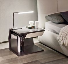 Modern Nightstands That Complete The Room With Their Uniqueness - Club is a nightstand with an architectural look and a very chic design. It was designed by Emanuele Zenere for Cattelan Italia and, despite its intricate look, it's a highly practical and functional piece of furniture. It has a white or graphite wooden frame and one drawer. The side surfaces are upholstered in leather.