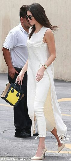 Birds of a feather: The 19-year-old supermodel's skinny trousers and maxi-top resembled the Narciso Rodriguez creation that the 34-year-old reality star donned last month