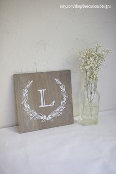 L Monogram sign hand painted on Graywash stained plywood. Wreath design. Bridesmaid / Groomsmen Gift. Personalized. Wedding. Housewarming. Anniversary