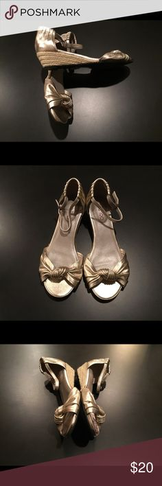 Me Too Gold Metallic Shoes Beautiful gold metallic Me Too shoes with a lovely twist over the toes. They have woven rope style wedges and a pretty gathering on the heels. Very versatile show that you can wear with dressy and non-dressy outfits. Excellent condition, very gently worn shoes. Me Too Shoes