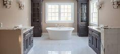 White soaking tub in bathroom | Brendon Homes