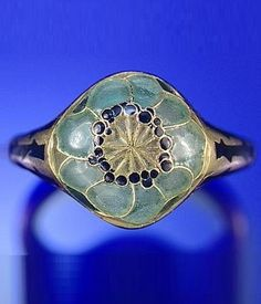 An Art Nouveau gold and enamel ring, by René Lalique, circa 1900. The bezel designed as a stylised poppy in enamel. #Lalique #ArtNouveau #ring