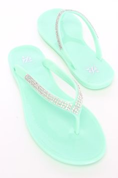 Slip into these adorable sandals with your next lovely outfit! Make sure to add these to your collection, it definitely is a must have! The features for these jelly sandals include a V strap design with a slip on design, rhinestone detailing, thong post, and smooth lining.