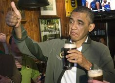 Obama gives a thumbs-up as he celebrates St. Patrick's Day in Washington