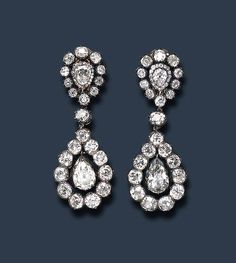 AN EXQUISITE PAIR OF GEORGIAN DIAMOND EAR PENDANTS   Each drop-shaped pendant centering upon an independent pear-shaped diamond, within an old mine-cut diamond frame, suspended by a diamond collet from a similarly-set surmount, mounted in silver and gold, circa 1800, with later findings, in a red leather case