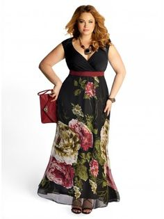 The Fantasy Floral gown is a black v-neck maxi gown with an empire waist. The gown has a burgundy and green floral print cascading down the skirt. The Fantasy Floral gown has a burgundy accent belt at the empire waist. Pair the Fantasy Floral gown with a pair of heels and a black cape or caplet. The gown is perfect for holiday parties, black tie weddings and to wear to the ballet.