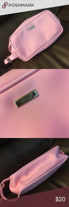 Versace nice perfume bag Very nice bag inside is like new out side is one small stein but bag is very nice can be use for perfumes or make up bag versage Bags Cosmetic Bags & Cases