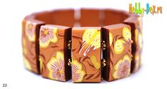 good pictures of the flower cane used & how to make the tiled bracelet.  ~ Polymer Clay Tutorials