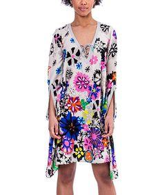 Look at this #zulilyfind! White Floral Naive Tunic #zulilyfinds
