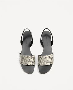 a6aec5aac7 Image 1 of EMBOSSED CONTRAST SLIDES from Zara Women's Shoes Sandals, Flat  Sandals, Zara