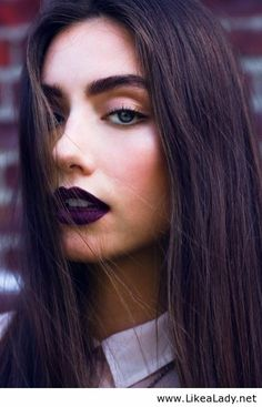 A dark lip allows for minimal eye makeup and bold brows
