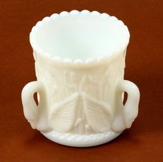 Westmoreland Swans in Rushes Toothpick Holder Milk Glass Vtg.  I have this piece; it was my sister's.