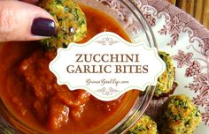 This zucchini garlic bites recipe combines shredded zucchini with garlic, Parmesan, fresh herbs and is served with a marinara sauce for an Italian twist.