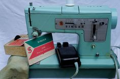 Vintage Robins Egg Blue Singer Zig Zag Model 338 Sewing Machine. $179.85, via Etsy.
