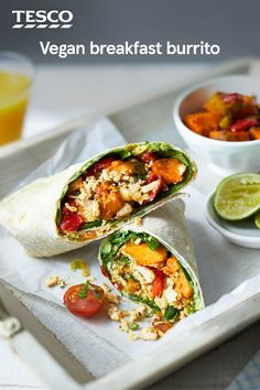 Start the day with this veg-packed breakfast burrito recipe - a vegan twist on the Mexican classic. Filled with roasted sweet potato and red pepper, avocado salsa and scrambled tofu, this burrito recipe is a winner. | Tesco