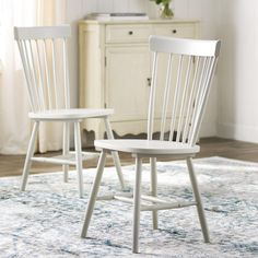 With its spindled back and flared frame, this Saint-Pierre Solid Wood Dining Chair offers a classic touch for any ensemble. It's an effortless way to update your dining set, but looks equally stylish paired with eclectic furnishings in the den. Decor, Dining Room Design, Wood Side Chair, Furniture, Solid Wood Dining Table, Chairs For Sale, Wood Dining Table, Solid Wood Dining Chairs, Kitchen Chairs