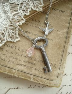 SECRET GARDEN - Antique Skeleton Key Necklace. Vintage Key Necklace with Bird and Glass Flower. Sweet & Shabby, Rustic Garden Necklace.. $32.50, via Etsy.