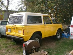 Yellow 1970 Ford Bronco early SUV