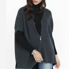Black Friday Sale! BNWT Express Poncho/Cardigan A combination of a poncho and a cardigan, this heavy marl shaker knit sweater is a substantial ally for cooler weather. Short Dolman sleeves and an extreme hi-lo hem give it a dramatic silhouette. Try it over jean leggings with a long-sleeve t-shirt.  V-Neck Short Dolman sleeves Shaker knit Extreme hi-lo hem Cotton/Acrylic Express Sweaters Cardigans