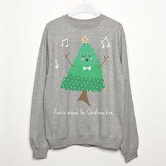 Rockin Around The Christmas Tree Sweatshirt. Shop Christmas Jumpers now.